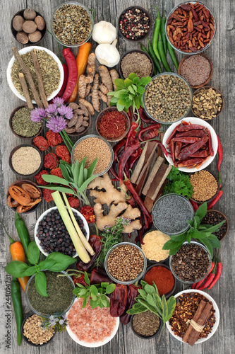 Spice and herb food seasoning collection with fresh and dried spices and herbs Top view.