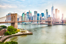 Amazing Panorama View Of New York City Skyline And Brooklyn Bridge With Skyscrapers And East River Flowing During Daytime In United States Of America