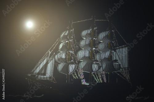 Fotografie, Obraz  Pirate ghost ship in a night sea background.