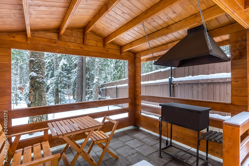 Tablou Canvas Arbor with barbecue on a snowy yard