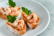 Bruschetta Sandwiches With Shrimps, Creamy Sauce And Parsley.