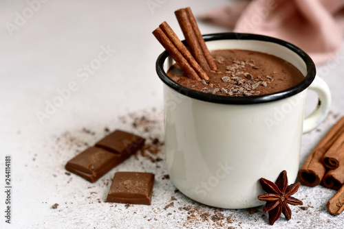 Spoed Foto op Canvas Chocolade Homemade hot chocolate in a white enamel mug.