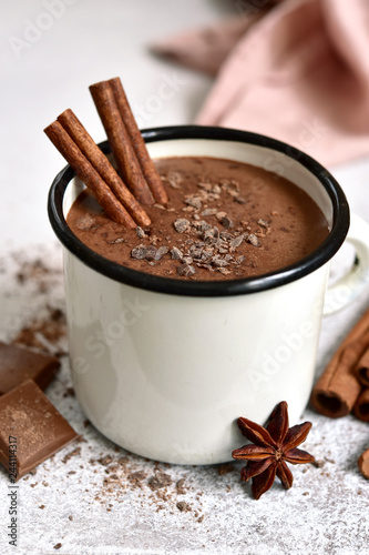 Poster Chocolate Homemade hot chocolate in a white enamel mug on a light slate, stone or concrete background.