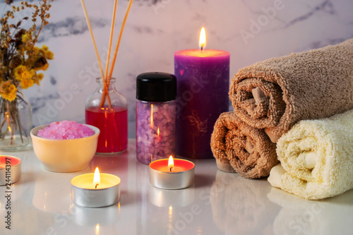 Fotografie, Obraz  Spa treatment set with scented salt, candles, towels and aroma oil