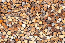 Pieces Of Firewood Forming A Background