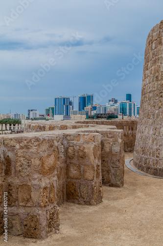 Bahrain Fort (Qal'at al-Bahrain) and Manama skyline in