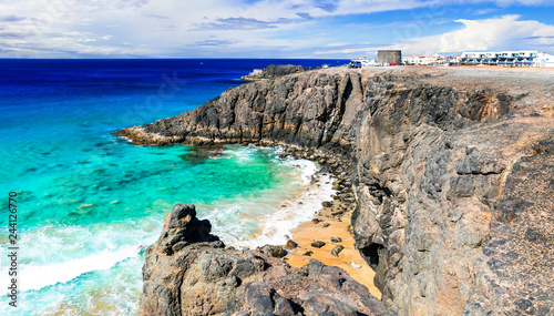 Fuerteventura - view of rocky beach and Toston tower in El Cotillo. Canary islands