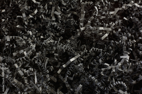 Obraz na plátne  Close up of crinkled shredded black paper box filler for shipping fragile items