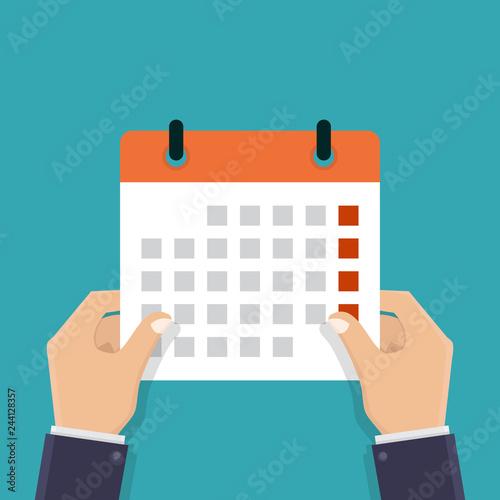Photo  Hand holding a calendar, business plans, strategic plans, teamwork, new ideas, f