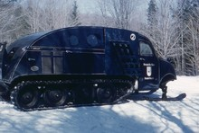 Vintage Snow Mobile From Ski Lodge In Winter With Snow