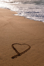 Heart Drawn In The Sand On The...