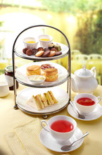 Delicious English Afternoon Tea Set On A White Background
