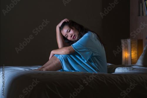 dramatic portrait of young beautiful and sad Asian Chinese woman crying desperat Fototapeta