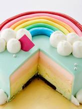 Beautifully Designed Rainbow Cake On White Background