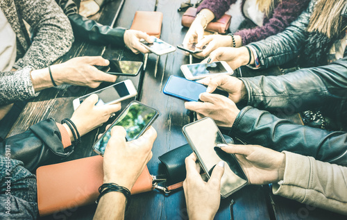 Fotografie, Obraz People hands having addicted fun together using smartphone - Millenial sharing c