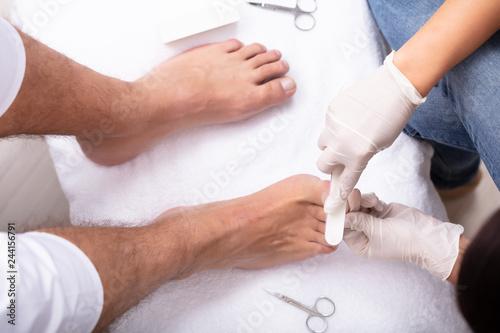 Foto op Canvas Pedicure Man Undergoing Pedicure Process In Salon