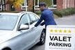 Happy Male Valet Opening Car Door