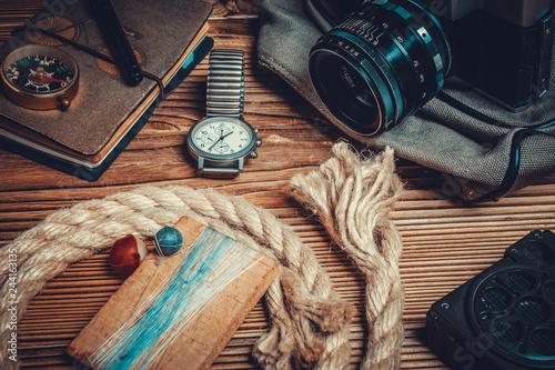 traveler or adventurer accessories on wood background Canvas Print
