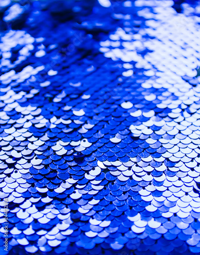 Fotografie, Obraz  Bright shiny texture of colorful sequins in blue and purple colors