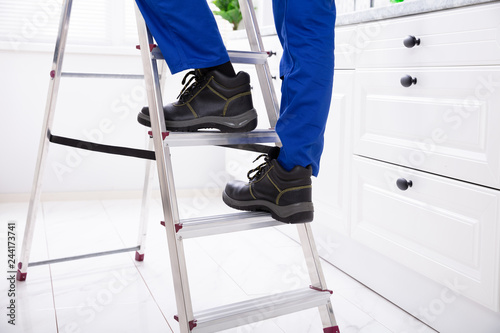 Pleasing Man Stepping On Ladder Buy This Stock Photo And Explore Machost Co Dining Chair Design Ideas Machostcouk