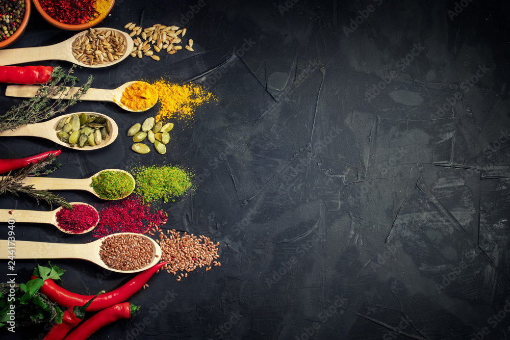 Fototapety, obrazy: A set of spices and herbs on black stone plate. Top view with free space for menu or recipes