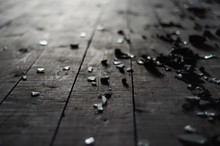Small Shards Of Glass On The Dark Wooden Floor