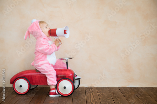 Funny kid wearing Easter bunny