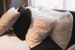 Bed maid-up with clean white pillows and bed sheets in beauty bedroom. Close-up. interior background