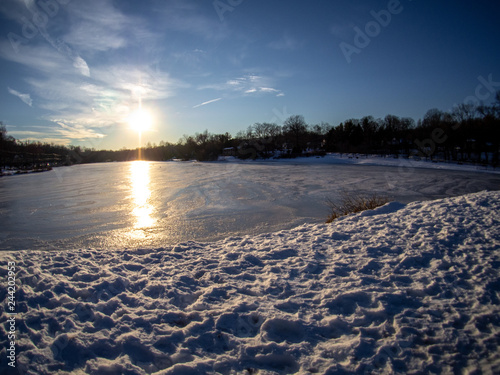 Fotografie, Obraz  wide angle view of frozen lake in winter end of afternoon