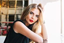Closeup Portrait Beautiful Woman Leaning On Table In Cafeteria. She Has Red Lips, Long Blonde Hair, Looking To Camera