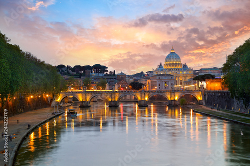 In de dag Centraal Europa St. Peter's Basilica and Bridge Sant Angelo at sunset in Rome, Italy