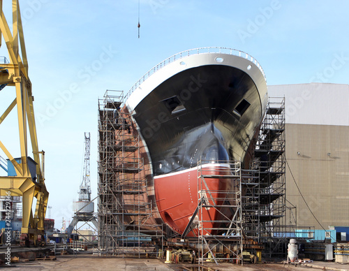 Fototapeta New big ship on dry dock in shipyard
