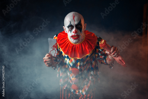 Photo  Bloody clown with meat cleaver and baseball bat