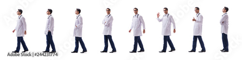 Valokuva  Young doctor physician standing walking isolated on white backgr