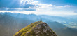 canvas print picture - man on the top of a rock meeting sun