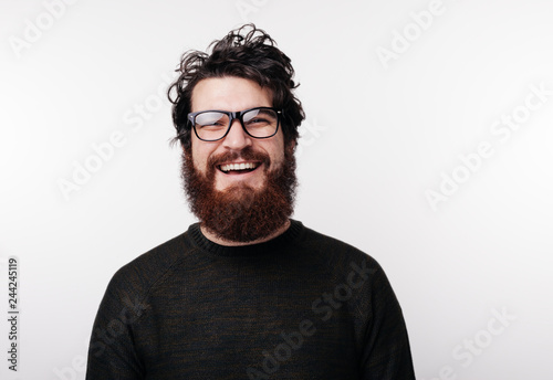 Fototapety, obrazy: Handsome bearded boy in glasses smiles and looks at the camera