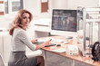 Pleasant woman sitting at the office table