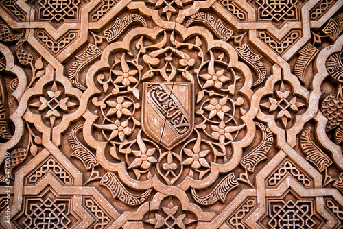 Photo Detail of Islamic stone carving on a wall in the royal palace Nazaries of the Al