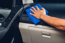 Worker Man Cleaning Dust Interior By Cloth Microfiber Inside Car