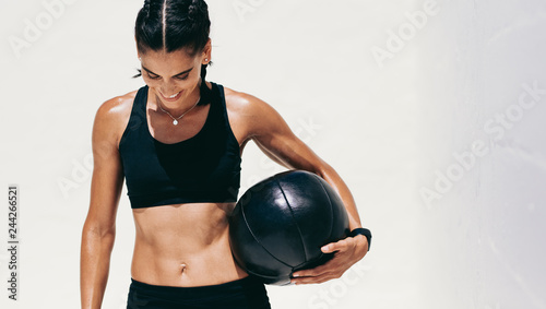 Fotografie, Obraz  Smiling fitness woman standing with a medicine