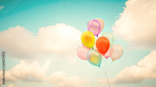 Fototapeta Vintage multicolor balloons with done with a retro instagram filter effect on blue sky
