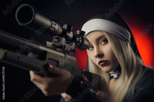 Fotografia, Obraz Fine art portrait of a novice nun in deep prayer with rosary