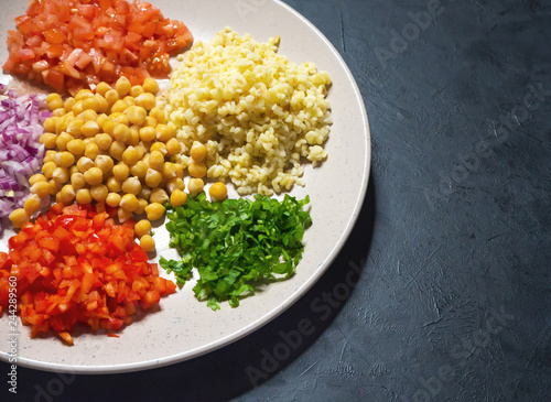 Arabic Food: Bulgur wheat, vegetable and chickpea pilaf. Set of ingredients.