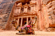 Leinwanddruck Bild - Spectacular view of two beautiful camels in front of Al Khazneh (The Treasury) in Petra. Petra is a historical and archaeological city in southern Jordan.