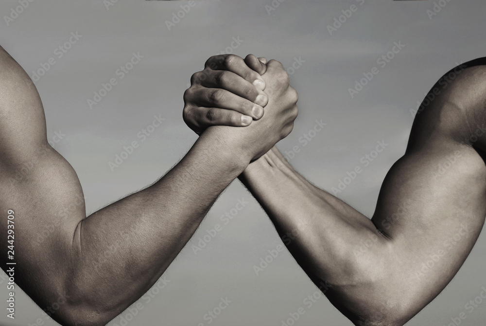 Fototapety, obrazy: Rivalry, vs, challenge, strength comparison. Two men arm wrestling. Arms wrestling, competition. Rivalry concept - close up of male arm wrestling. Leadership concept. Black and white.