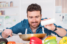 Cheerful Young Man Preparing Food At Home