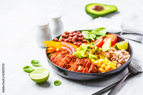 Deurstickers Verse groenten Mexican chicken burrito bowl with rice, beans, tomato, avocado,corn and spinach. Mexican cuisine food concept.