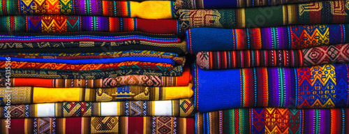 Peruvian traditional colourful native handicraft textile fabric at market in Machu Picchu, one of the New Seven Wonder of The World, Cusco Region Peru, South America Canvas Print