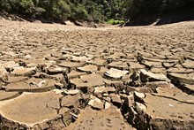 Dry Cracked River Bed. Drought...