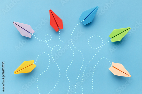 Photo  Paper planes with route trace on blue background